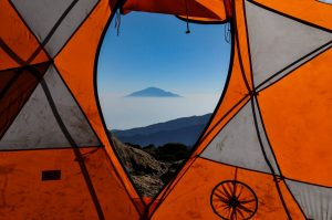 Tent and volcanix landscape in background